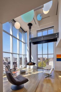 penthouse-large-double-height-space-anchored-corner-expansive-two-story-walls-glass-01-696×1044