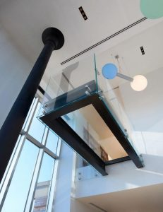 penthouse-large-double-height-space-anchored-corner-expansive-two-story-walls-glass-02-696×904