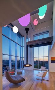 penthouse-large-double-height-space-anchored-corner-expansive-two-story-walls-glass-13-696×1127