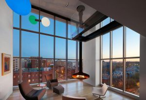 penthouse-large-double-height-space-anchored-corner-expansive-two-story-walls-glass-14-1068×732